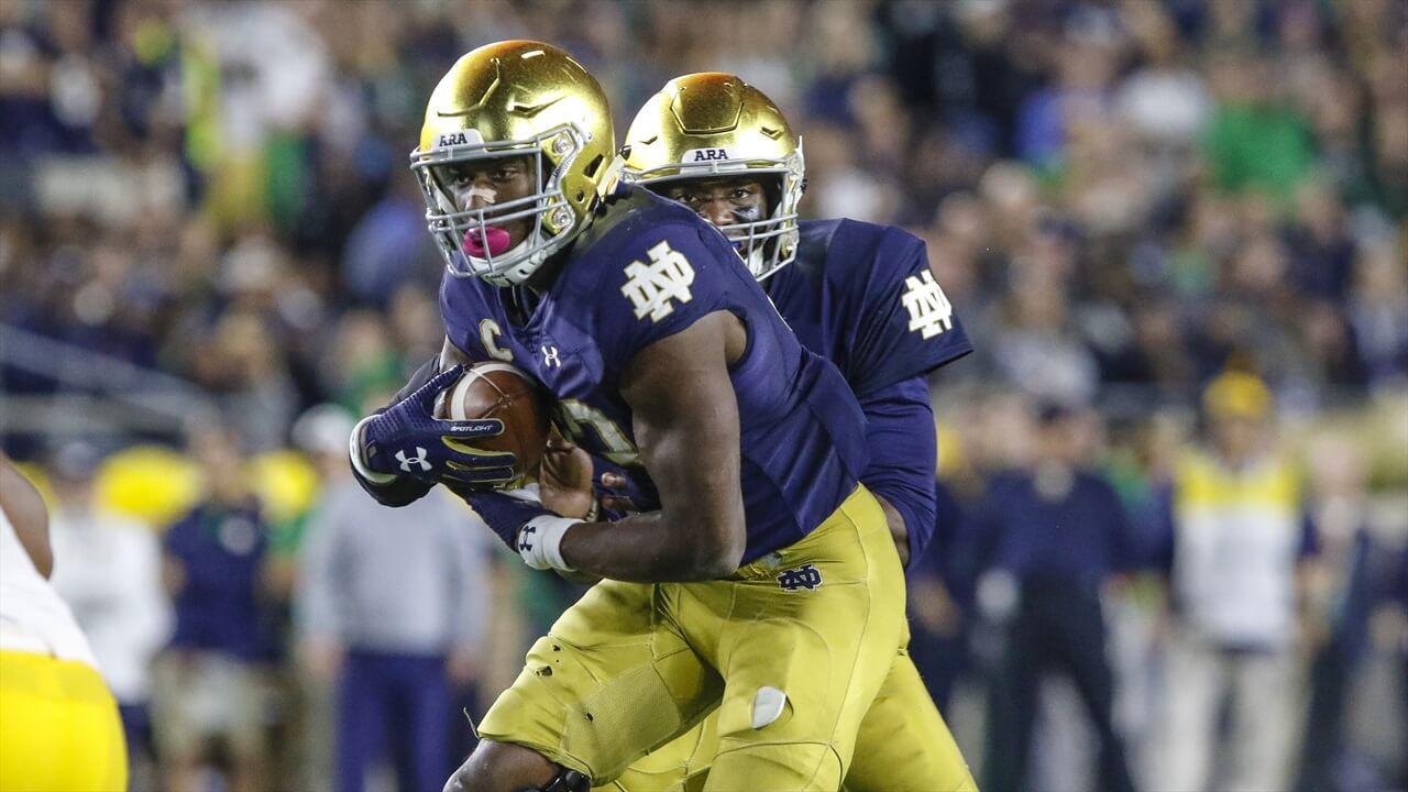 Josh Adams #33Trucking Notre Dame Running Back